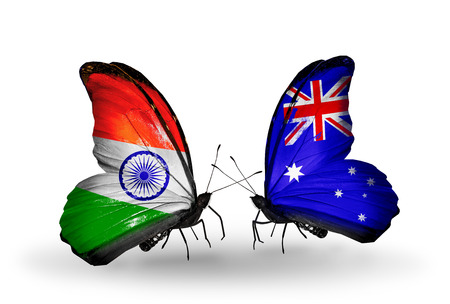 indian money: Two butterflies with flags on wings as symbol of relations India and Australia Stock Photo