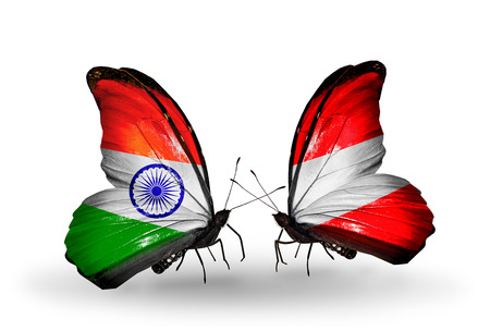 Two butterflies with flags on wings as symbol of relations India and Austria photo