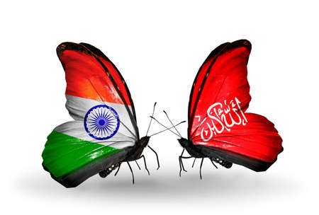 Two butterflies with flags on wings as symbol of relations India and Waziristan photo