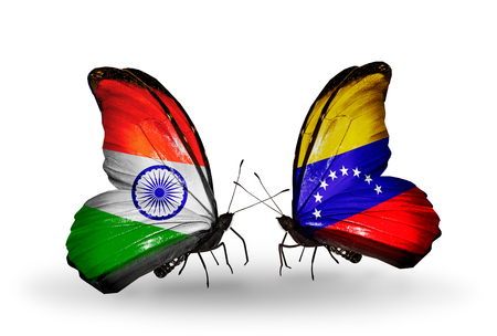 Two butterflies with flags on wings as symbol of relations India and Venezuela photo