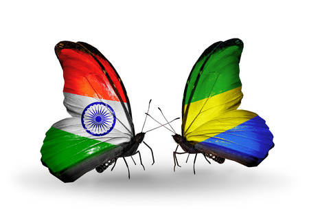 Two butterflies with flags on wings as symbol of relations India and Gabon photo