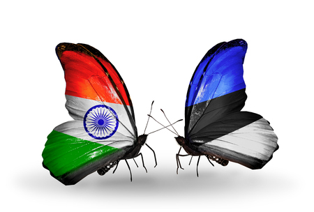 Two butterflies with flags on wings as symbol of relations India and Estonia photo