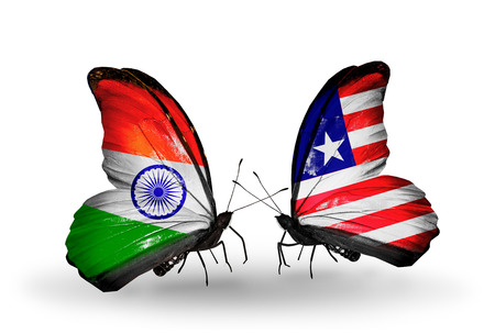 Two butterflies with flags on wings as symbol of relations India and  Liberia photo