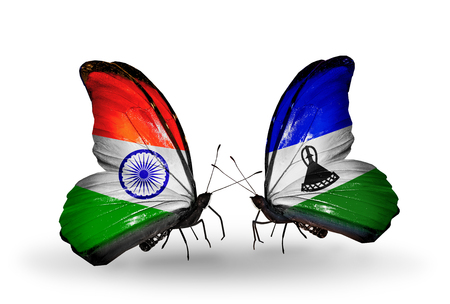 Two butterflies with flags on wings as symbol of relations India and Lesotho photo