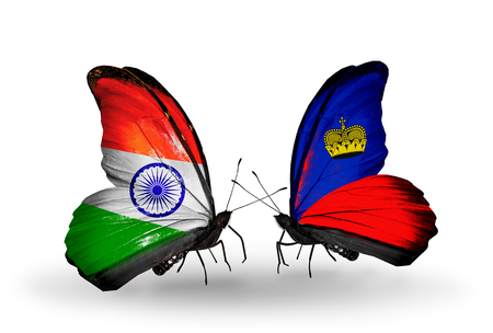 Two butterflies with flags on wings as symbol of relations India and Liechtenstein photo