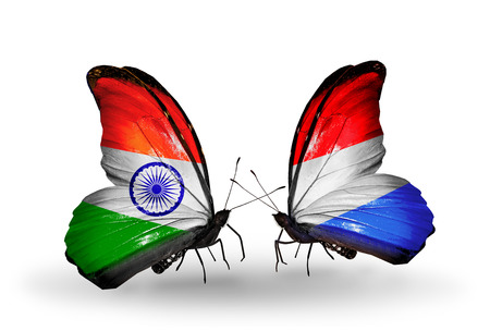 Two butterflies with flags on wings as symbol of relations India and  Luxembourg photo