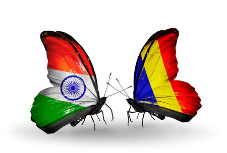 Two butterflies with flags on wings as symbol of relations India and Chad, Romania photo