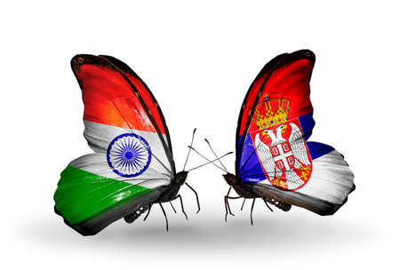 Two butterflies with flags on wings as symbol of relations India and Serbia photo