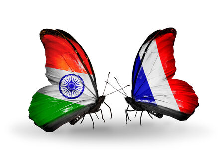 Two butterflies with flags on wings as symbol of relations India and France photo