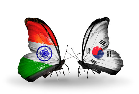 Two butterflies with flags on wings as symbol of relations India and South Korea photo
