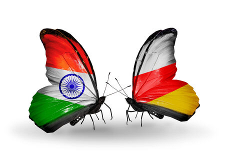 Two butterflies with flags on wings as symbol of relations India and South Ossetia photo