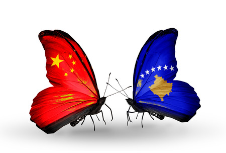 Two butterflies with flags on wings as symbol of relations China and Kosovo photo