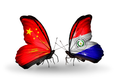 Two butterflies with flags on wings as symbol of relations China and Paraguay photo