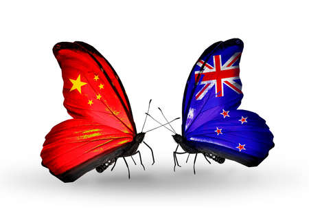 Two butterflies with flags on wings as symbol of relations China and New Zealand photo