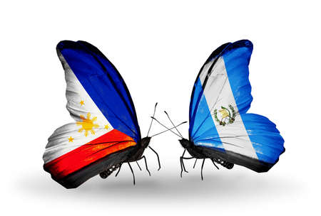 Two butterflies with flags on wings as symbol of relations Philippines and Guatemala photo
