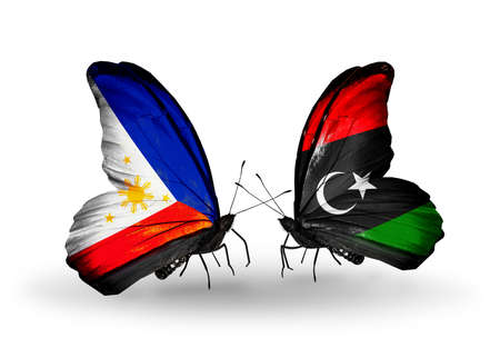 Two butterflies with flags on wings as symbol of relations Philippines and Libya photo