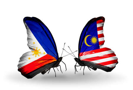 Two butterflies with flags on wings as symbol of relations Philippines and Malaysia photo