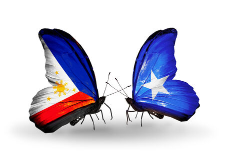Two butterflies with flags on wings as symbol of relations Philippines and Somalia photo