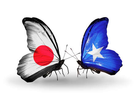 Two butterflies with flags on wings as symbol of relations Japan and Somalia photo