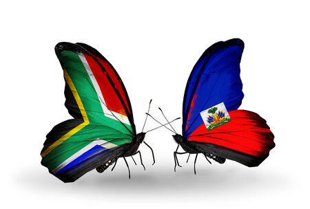 Two butterflies with flags on wings as symbol of relations South Africa and Haiti photo