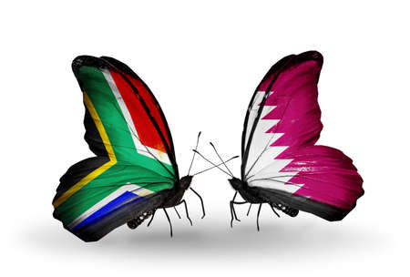 Two butterflies with flags on wings as symbol of relations South Africa and Qatar photo