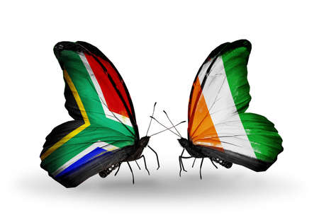 african solidarity: Two butterflies with flags on wings as symbol of relations South Africa and Cote Divoire Stock Photo