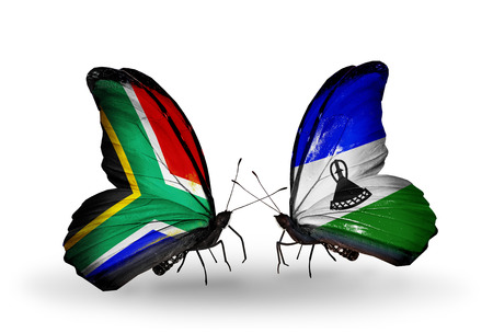 Two butterflies with flags on wings as symbol of relations South Africa and Lesotho photo