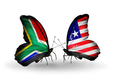 Two butterflies with flags on wings as symbol of relations South Africa and Liberia photo