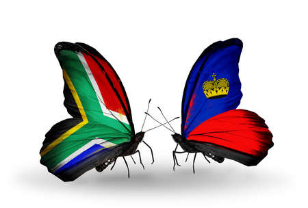 Two butterflies with flags on wings as symbol of relations South Africa and Liechtenstein photo