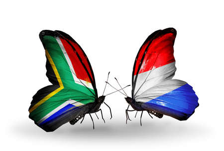 Two butterflies with flags on wings as symbol of relations South Africa and  Luxembourg photo