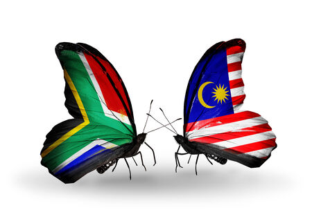 Two butterflies with flags on wings as symbol of relations South Africa and Malaysia photo
