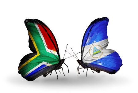 african solidarity: Two butterflies with flags on wings as symbol of relations South Africa and Nicaragua