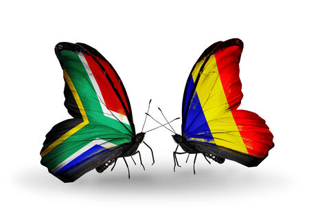 Two butterflies with flags on wings as symbol of relations South Africa and Chad, Romania photo