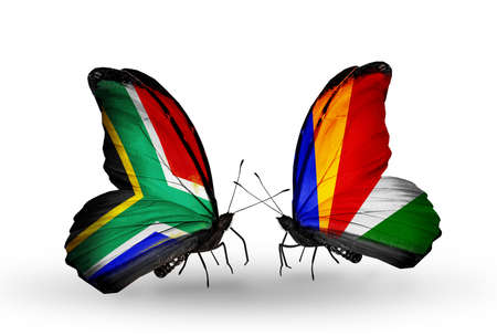 Two butterflies with flags on wings as symbol of relations South Africa and Seychelles photo