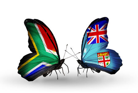 african solidarity: Two butterflies with flags on wings as symbol of relations South Africa and Fiji
