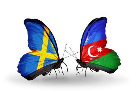 Two butterflies with flags on wings as symbol of relations Sweden and Azerbaijan photo