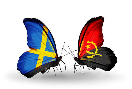 Two butterflies with flags on wings as symbol of relations Sweden and Angola photo