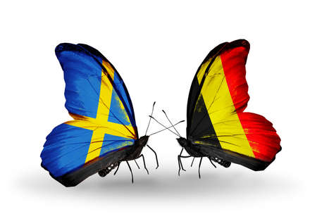 Two butterflies with flags on wings as symbol of relations Sweden and Belgium photo