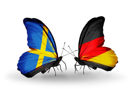 Two butterflies with flags on wings as symbol of relations Sweden and Germany photo