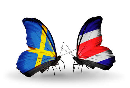 Two butterflies with flags on wings as symbol of relations Sweden and Costa Rica photo