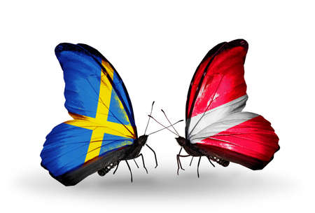 Two butterflies with flags on wings as symbol of relations Sweden and  Latvia photo