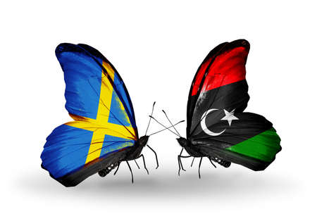 Two butterflies with flags on wings as symbol of relations Sweden and Libya photo