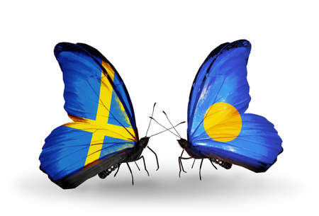 Two butterflies with flags on wings as symbol of relations Sweden and Palau Stock Photo