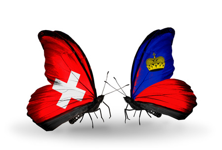 Two butterflies with flags on wings as symbol of relations Switzerland and Liechtenstein