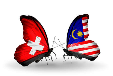 Two butterflies with flags on wings as symbol of relations Switzerland and Malaysia photo