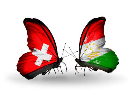 economy of tajikistan: Two butterflies with flags on wings as symbol of relations Switzerland and Tajikistan