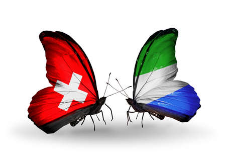 Two butterflies with flags on wings as symbol of relations Switzerland and Sierra Leone photo