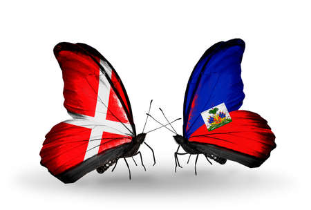 Two butterflies with flags on wings as symbol of relations Denmark and Haiti photo