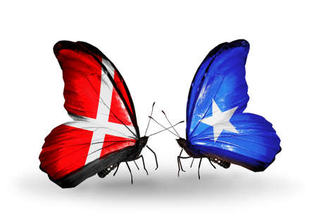 Two butterflies with flags on wings as symbol of relations Denmark and Somalia photo