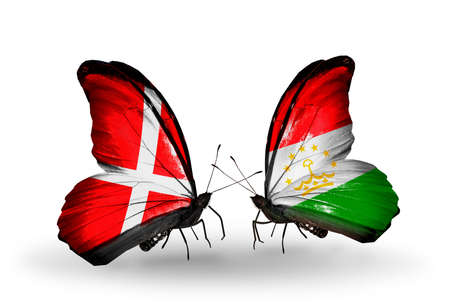 economy of tajikistan: Two butterflies with flags on wings as symbol of relations Denmark and Tajikistan Stock Photo